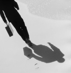 Businessman Leaving Footprints in Sand